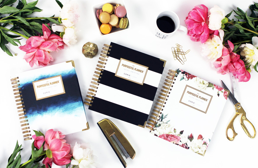 Purposeful Planners on Desk with Flowers and Accessories