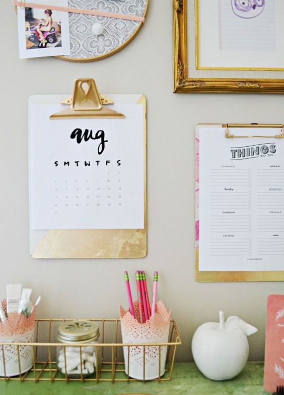 Trendy Office Gold Clipboards Hung On Office Wall to Hold Calendar and Lists Feminine Decor