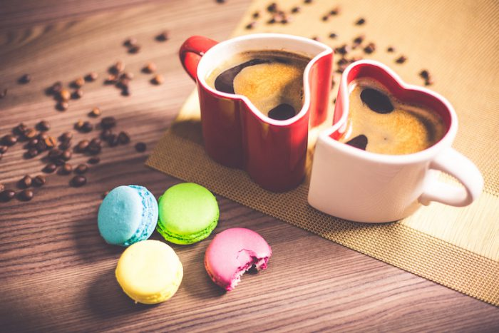 Colorful Macarons and Coffee in Heart Mugs Romantic Breakfast