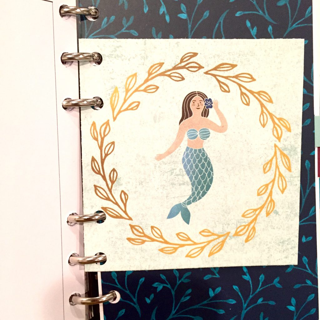 Happy As Annie: I punched holes in this double-sided mermaid journaling card from the Planner Girl Provisions June box to use a journaling card in my planner.