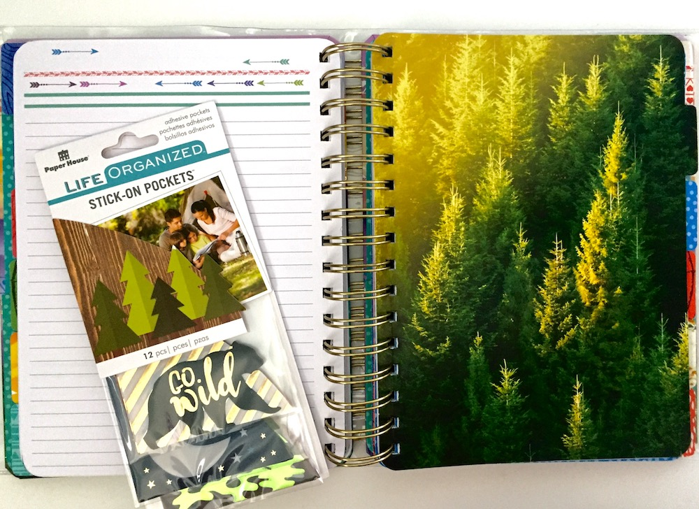 "Paper House's planner line, Life Organized, offers planners, like this undated ""Live Bold"" planner, and planner accessories like these Stick-On Pockets."