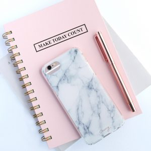 "Pink ""Make Today Count"" notebook with fancy pen and iphone in marble phone case on top of it"