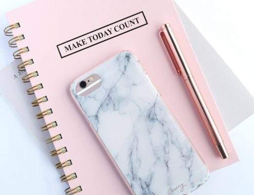 """Pink """"Make Today Count"""" notebook with fancy pen and iphone in marble phone case on top of it"""