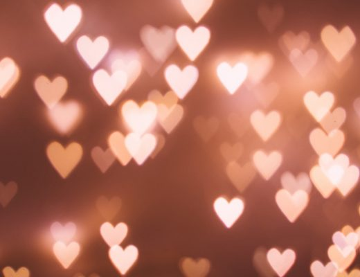 Heart lights overlapping against pink background