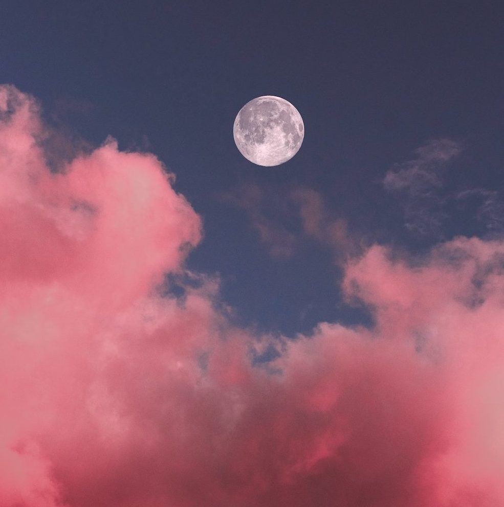 How to Interpret Your Dreams in 3 Steps | Happy As Annie | Best Life Book Club May selection is Steering by Starlight by Martha Beck, in which she explains how our intuition communicates with us through dreams. (Pink puffy clouds and blue sky with bright full moon in center)
