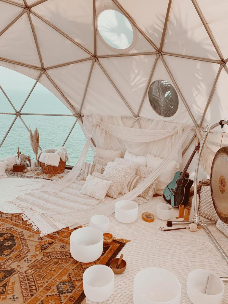 Happy As Annie | 7 Meditation Room from Pinterest You Ned to Copy - and how to get the look! (Malibu meditation space in tent with white and neutral textiles and white sound bath bowls)