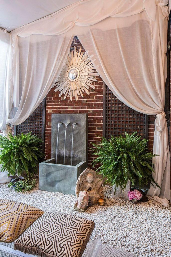 Happy As Annie | 7 Meditation Room from Pinterest You Ned to Copy - and how to get the look! (Water fountain and cushion pillows on gravel in outdoor space with exposed brickand drapes)