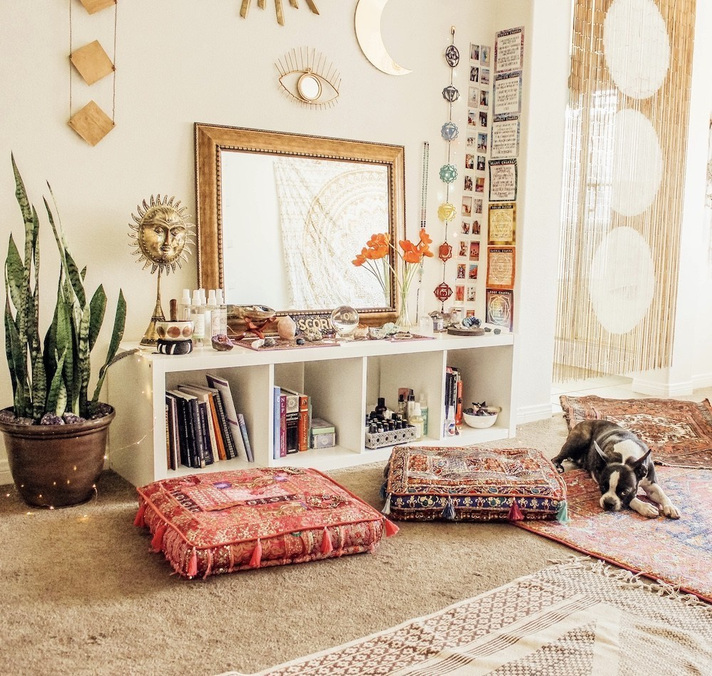 Happy As Annie | 7 Meditation Room from Pinterest You Ned to Copy - and how to get the look! (Dog laying on rugs next to cushion pillows in meditation space with spiritual decor and items)
