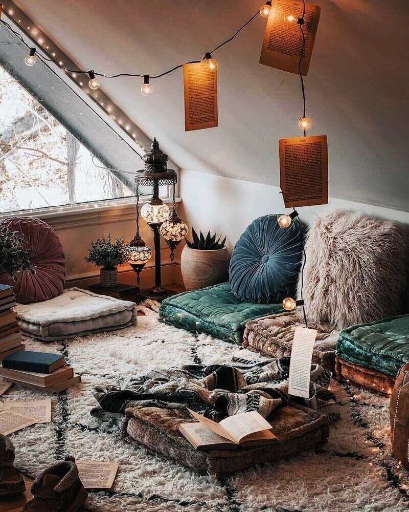 Happy As Annie | 7 Meditation Room from Pinterest You Ned to Copy - and how to get the look! (Meditation room with subdued jewel tone cushions and textiles and string lights)