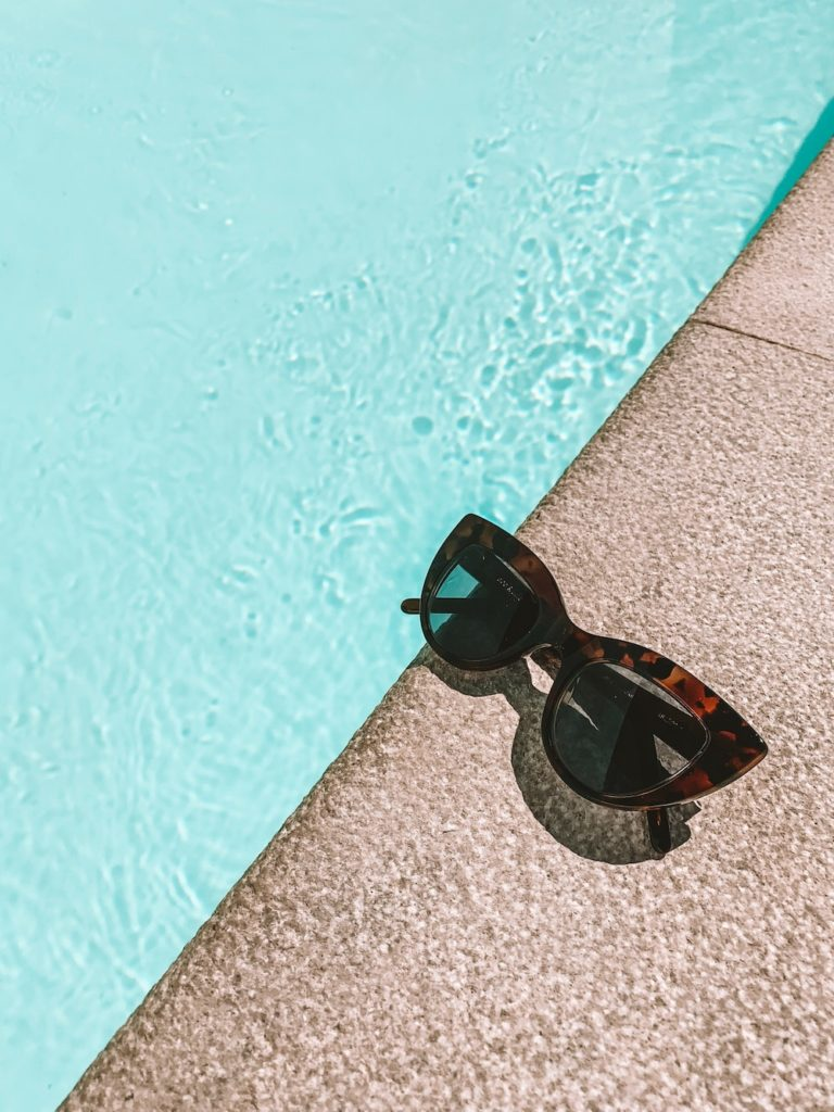 13 Essential Summer Must-Haves for Your Soul | Happy As Annie (Tortoise shell cat-eye sunglasses at edge of swimming pool)
