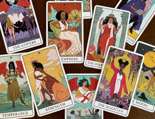 Major Arcana cards jumbled on wooden table, Modern Witch tarot deck
