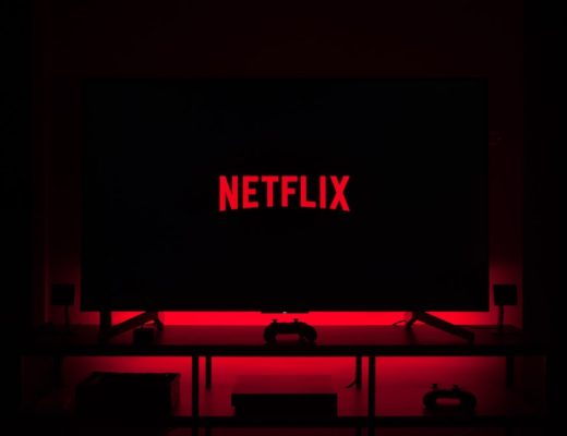 Red Netflix logo on black TV screen