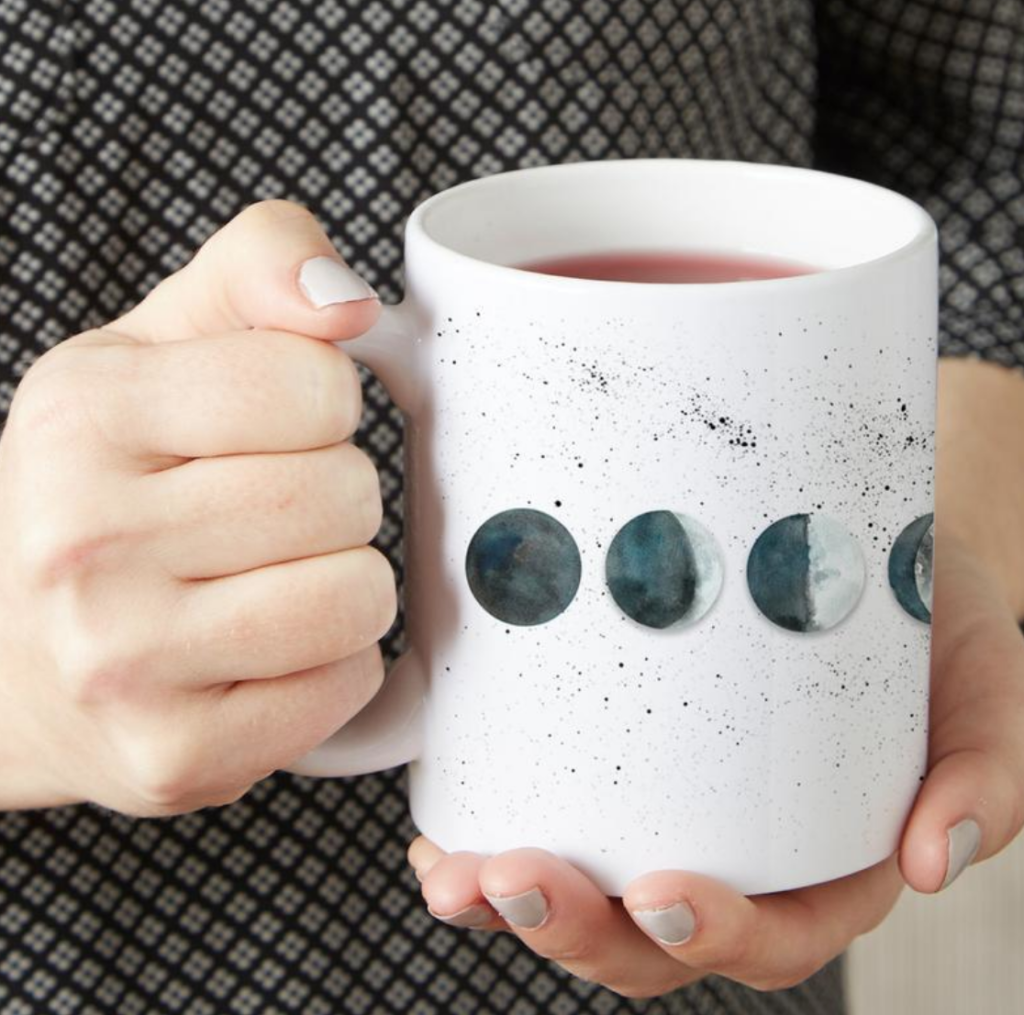 Watercolor moon phases coffee mug by Mirkwood  Scribes on Etsy on The Ultimate Witchy Gift Guide by Happy As Annie