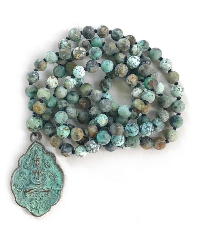 Mala with African turquoise beads by True Nature Jewelry on Etsy on The Ultimate Witchy Gift Guide by Happy As Annie