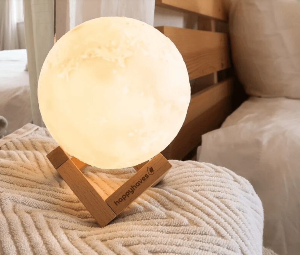 Light-up full moon essential oil diffuser on The Ultimate Witchy Gift Guide by Happy As Annie