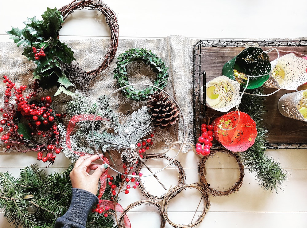 Make an Evergreen and Holly Wreath for Winter Solstice and Yule | 9 Ways to Celebrate the Winter Solstice by Happy As Annie